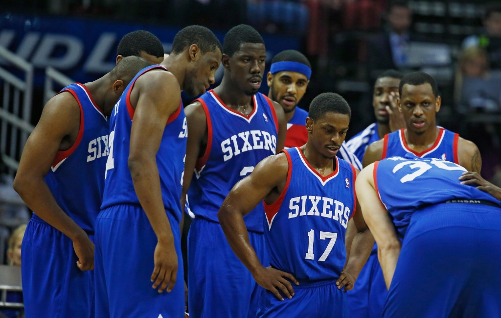 HOUSTON, TX - MARCH 27: The Philadelphia 76ers wait near the bench during a timeout during the game against the Houston Rockets at the Toyota Center on March 27, 2014 in Houston, Texas. NOTE TO USER: User expressly acknowledges and agrees that, by downloading and or using this photograph, User is consenting to the terms and conditions of the Getty Images License Agreement. (Photo by Scott Halleran/Getty Images)