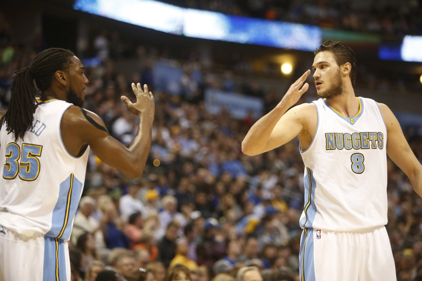 Mar 13, 2015; Denver, CO, USA; Denver Nuggets forward Danilo Gallinari (8) and Denver Nuggets forward Kenneth Faried (35) celebrate during the first half at Pepsi Center. Mandatory Credit: Chris Humphreys-USA TODAY Sports