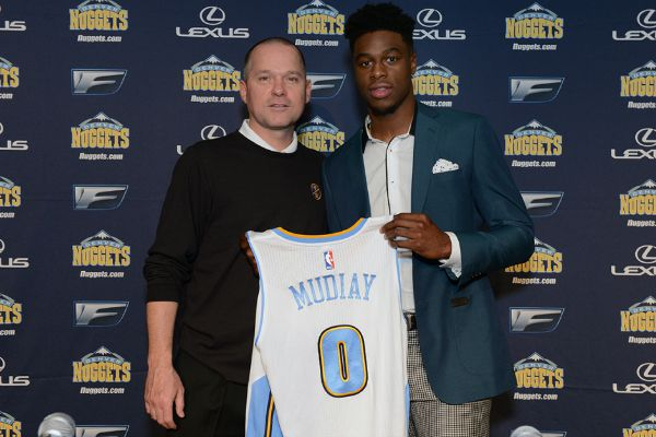 DENVER, CO - JUNE 26: The seventh selection in the 2015 NBA Draft Emmanuel Mudiay #0 and Head Coach Mike Malone of the Denver Nuggets pose for a photo during a press conference on June 26, 2015 at the Pepsi Center in Denver, Colorado. NOTE TO USER: User expressly acknowledges and agrees that, by downloading and/or using this Photograph, user is consenting to the terms and conditions of the Getty Images License Agreement. Mandatory Copyright Notice: Copyright 2015 NBAE (Photo by Garrett W. Ellwood/NBAE via Getty Images)