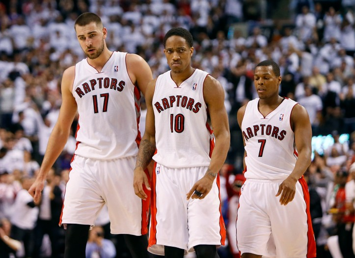 Apr 22, 2014; Toronto, Ontario, CAN; Toronto Raptors guard DeMar DeRozan (10) and center Jonas Valanciunas (17) and guard Kyle Lowry (7) come off the court after a play against the Brooklyn Nets in game two during the first round of the 2014 NBA Playoffs at Air Canada Centre. Toronto defeated Brooklyn 100-95. Mandatory Credit: John E. Sokolowski-USA TODAY Sports