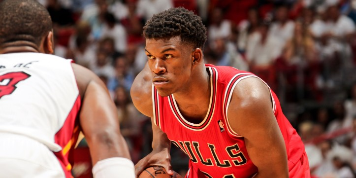 MIAMI, FL - MAY 6: Jimmy Butler #21 of the Chicago Bulls controls the ball against the Miami Heat in Game One of the Eastern Conference Semifinals during the 2013 NBA Playoffs on May 6, 2013 at American Airlines Arena in Miami, Florida. NOTE TO USER: User expressly acknowledges and agrees that, by downloading and/or using this photograph, user is consenting to the terms and conditions of the Getty Images License Agreement. Mandatory copyright notice: Copyright NBAE 2013 (Photo by Issac Baldizon/NBAE via Getty Images)