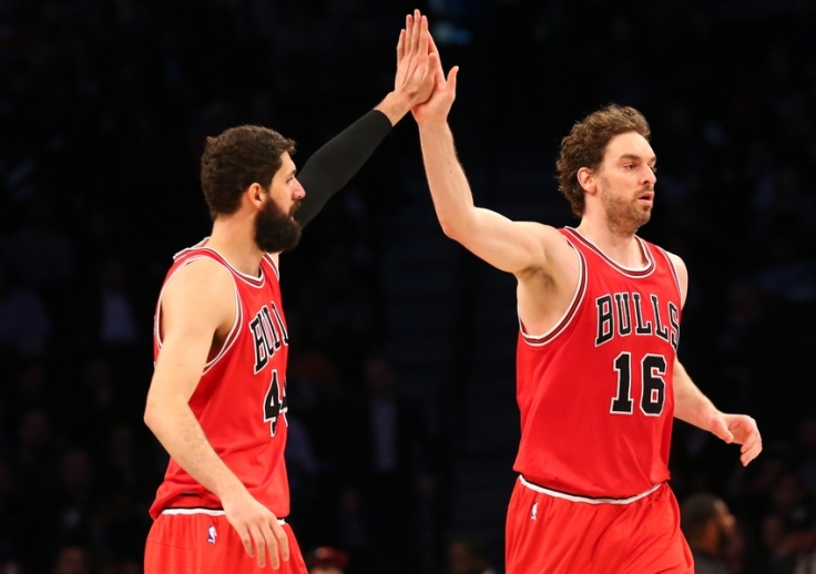 Apr 13, 2015; Brooklyn, NY, USA; Chicago Bulls forward Pau Gasol (16) high fives forward Nikola Mirotic (44) after scoring during the fourth quarter against the Brooklyn Nets at Barclays Center. Chicago Bulls won 113-86. Mandatory Credit: Anthony Gruppuso-USA TODAY Sports