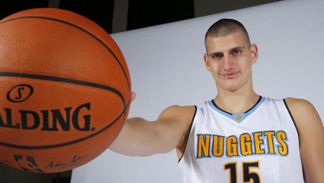 Nikola Jokic poses during Denver Nuggets media day Monday, Sept. 28, 2015. (AP Photo/Jack Dempsey)